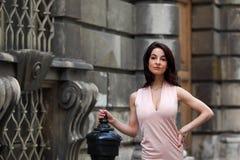 Elegant brunette woman on the street of a European city Stock Photos