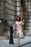 Elegant brunette woman on the street of a European city Stock Photos