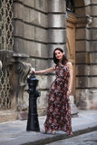 Elegant brunette woman on the street of a European city Royalty Free Stock Image