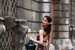 Elegant brunette woman on the street of a European city Stock Images