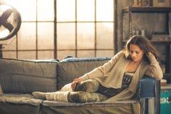 An elegant brunette woman wearing comfortable Royalty Free Stock Image