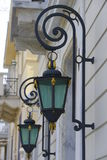 Elegant building facade street lamps Royalty Free Stock Images