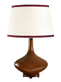 Elegant bulbous brown table lamp with shade. Elegant bulbous brown table lamp with a white shade with matching trim isolated on white for interior design Royalty Free Stock Images