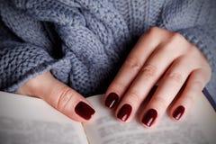 Elegant burgundy nails Royalty Free Stock Images