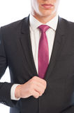 Elegant business male model fixing his suit jacket Royalty Free Stock Photo