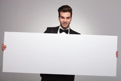 Elegant business man holding a blank board Stock Image