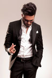 Elegant business man looking down Stock Photos