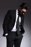 Elegant business man looking down Royalty Free Stock Image