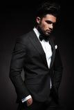 Elegant business man posing on black background Royalty Free Stock Images