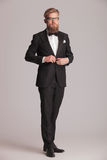 Elegant business man standing on grey studio backgroud Royalty Free Stock Photo