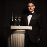 Elegant business man standing near a white column Stock Photo