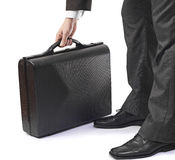 Elegant business man in suit holding briefcase Stock Photography