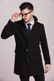 Elegant business man taking off his glasses Stock Photo