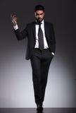 Elegant business man walking forward Royalty Free Stock Image