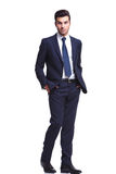 Elegant business man walking with his hands in his pocket Stock Photography
