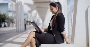 Elegant business manageress working on a laptop Royalty Free Stock Images