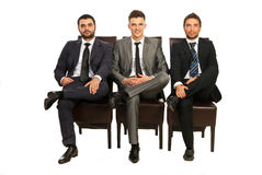 Elegant business men sitting chairs Royalty Free Stock Photos