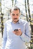 elegant business multitasking multimedia man calling with smartphone stock images