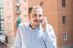 elegant business multitasking multimedia man calling with smartphone stock photo