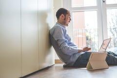 Elegant business multitasking multimedia man Stock Photos