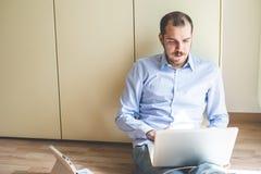 Elegant business multitasking multimedia man Stock Images
