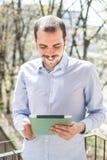 Elegant business multitasking multimedia man stock image