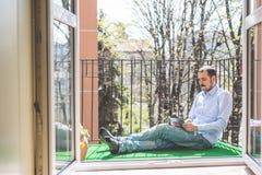 Elegant business multitasking multimedia man royalty free stock photo