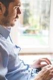 Elegant business multitasking multimedia man royalty free stock image