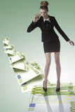 Elegant business woman on eoro trampoline Royalty Free Stock Photos