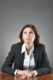 Elegant business woman with eyes to the sky Royalty Free Stock Photo