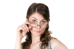 Elegant business woman with glasses smiling coquettishly Stock Photo