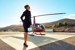 Elegant business woman. Near the helicopter. Business, success and luxury concept Stock Photography