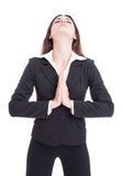 Elegant business woman praying with eyes closed Royalty Free Stock Image