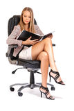 Elegant business woman reading a project Stock Photography