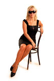 Elegant business woman sits on chair. At studio Stock Photos