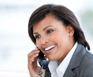 Elegant business woman talking on phone Stock Images