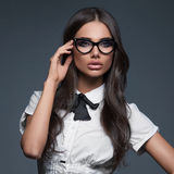 Elegant business woman wearing eyeglasses royalty free stock photography