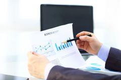 Elegant businessman analyzing data in office. Elegant businessman analyzing data in white office Stock Images