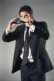 Elegant businessman with binocular Stock Image