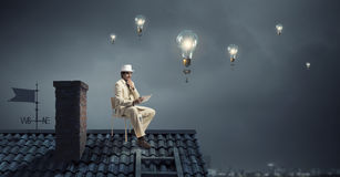 Elegant businessman in cylinder hat . Mixed media Royalty Free Stock Photos