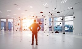Networking and social communication concept as effective point for modern business. Elegant businessman in 3D office interior and social connection concept Stock Photos