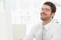 Elegant businessman with glasses laughing Royalty Free Stock Photography