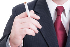 Elegant businessman hand holding an unlit cigarette Stock Photo