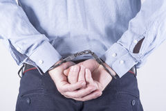 Elegant businessman in handcuffs Royalty Free Stock Images