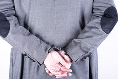 Elegant businessman in handcuffs Stock Photo