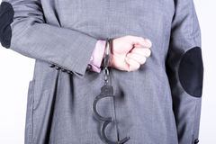 Elegant businessman in handcuffs Stock Image