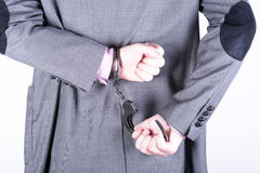 Elegant businessman in handcuffs Stock Photography
