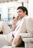 Businessman speaking on cell phone. Royalty Free Stock Images