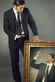 Elegant businessman and his angry paint Royalty Free Stock Photography
