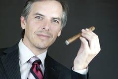 Elegant Businessman Holds Cigar Royalty Free Stock Image